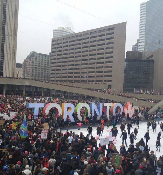 The Toronto Women's March on Washington assembles in Nathan Phillips Square. Image courtesy H.G. Watson.