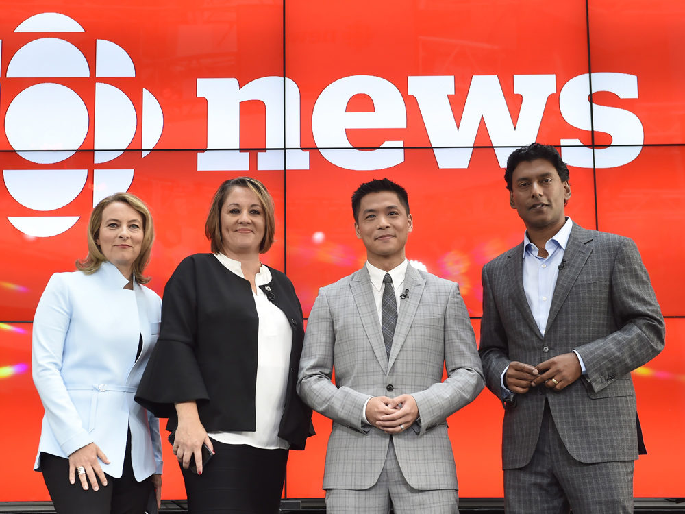 """Adrienne Arsenault, Rosemary Barton, Andrew Chang and Ian Hanomansing (left to right) are named the new hosts of """"The National,"""" at a news conference in Toronto, Tuesday, Aug.1, 2017 Nathan Denette/Canadian Press"""