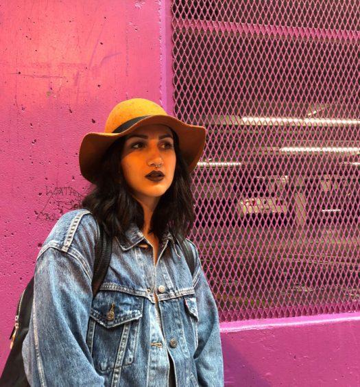 Anya Zoledziowski pictured in front of pink wall