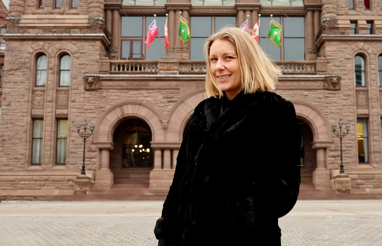 Allison Smith stands outside Queen's Park