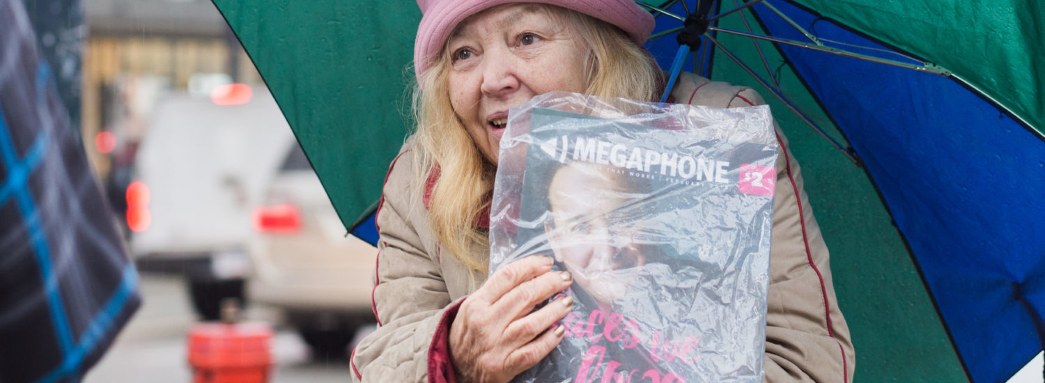Joan M. sells copies of Megaphone Magazine in Downtown Vancouver in 2018