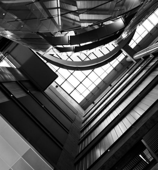 The interior of the Bahen Centre for Information Technology in black and white.