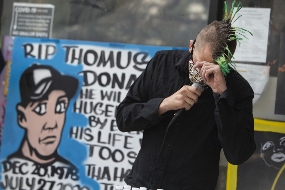 Vancouver OPS manager Trey Helten is overcome with emotion while speaking at a memorial for Donaghy, who was a friend of his. Friends and colleagues say his death has highlighted the risks frontline workers like him face in their efforts to combat the overdose crisis.