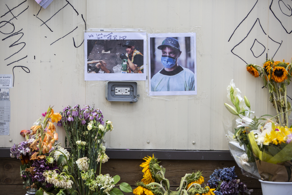 A small memorial is seen outside the overdose prevention site trailer near where Thomus Donaghy was killed on July 27, 2020, during a break from his shift in Vancouver's West End.