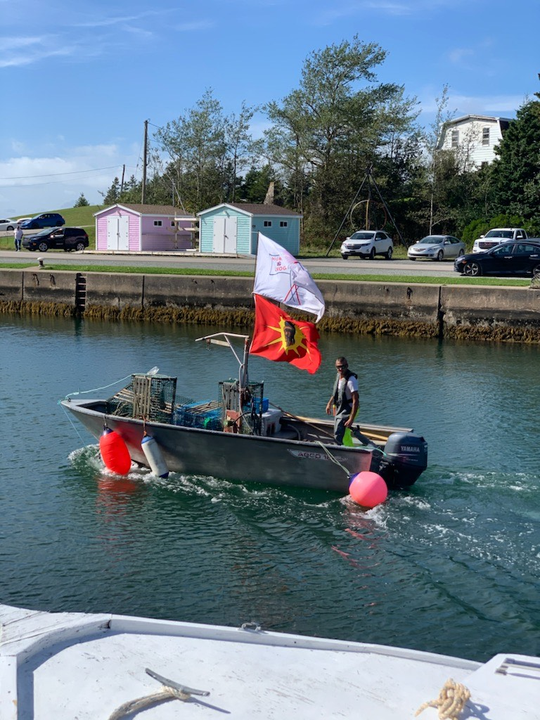 Craig Doucette heads out on to the St. Peter's Bay to set traps, as he asserts his treaty rights under the Potlotek First Nation's moderate livelihood fishery plan