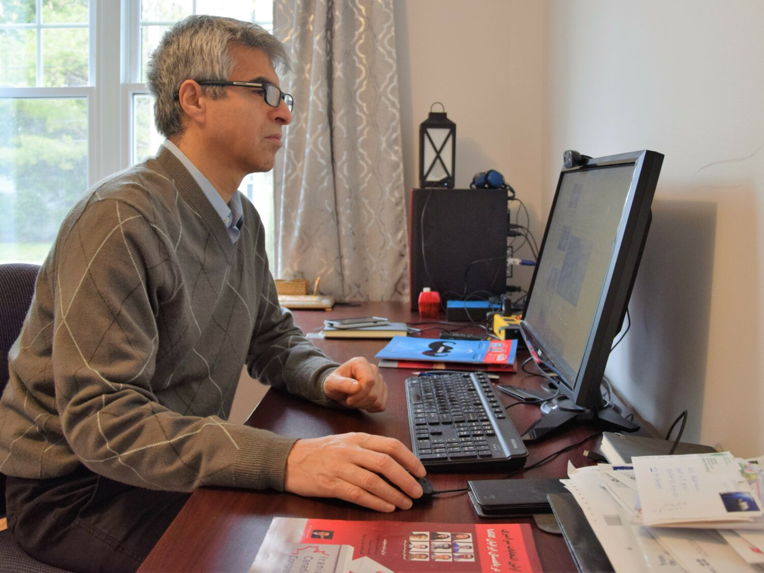 Khosro Shemiranie, HafteH's publisher and editor-in-chief, works in his Montreal office.