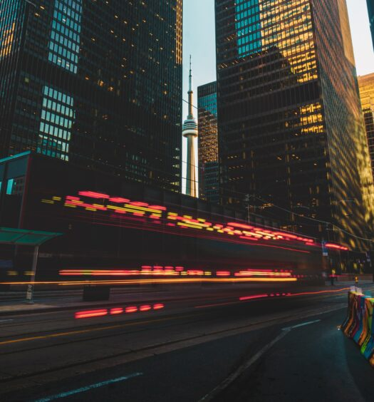 CN Tower at Sunset with light trails from a Fire Truck whizzing by.