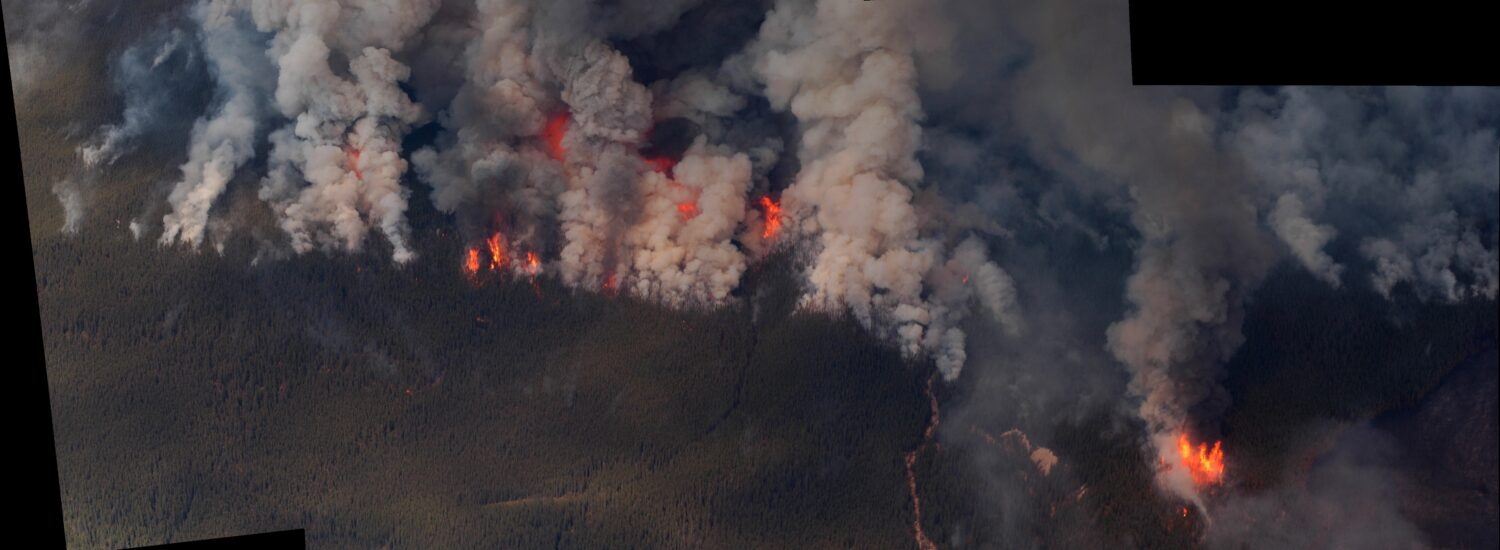 Stitched panorama aerial view of a forest fire in Alberta