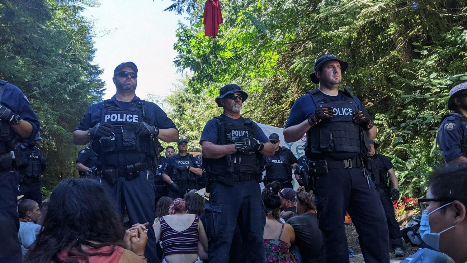 RCMP officers surround a group of blockaders.